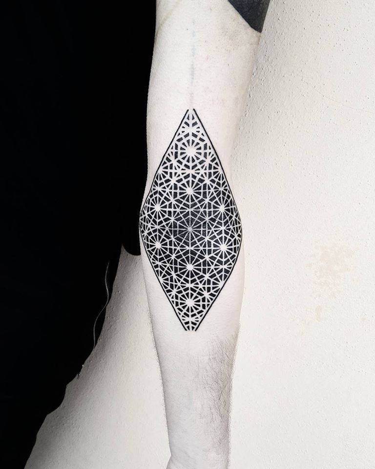 Gorgeous negative space pattern tattoo