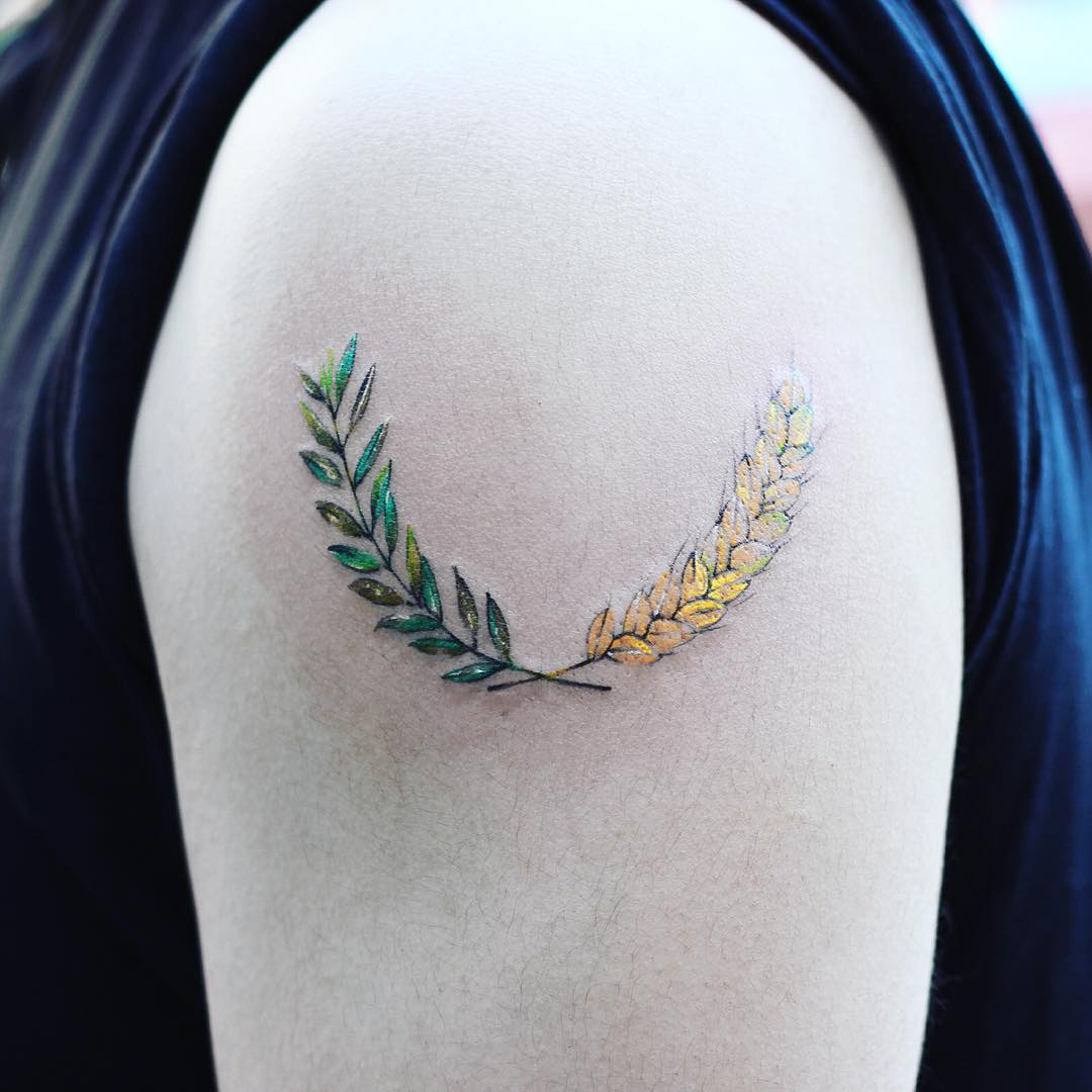 Green and yellow wheat twigs tattoo by yuni
