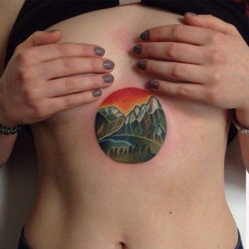 Greenish mountains tattoo