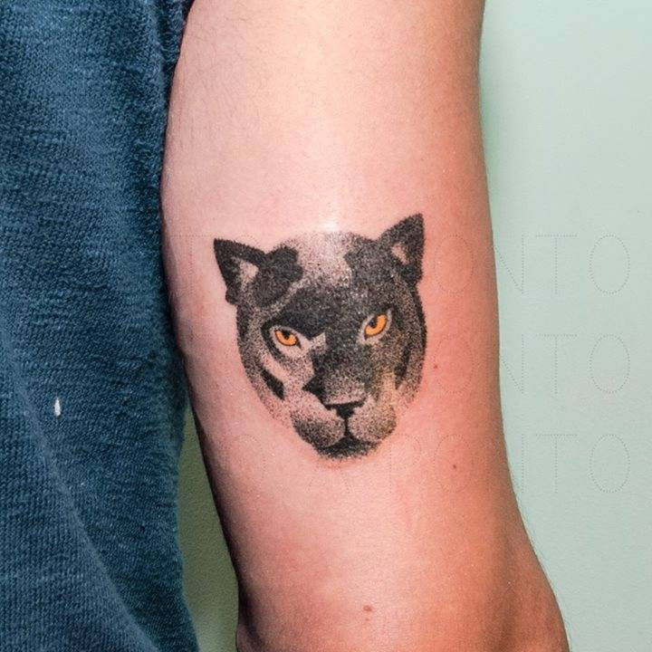 Hand poked panther tattoo