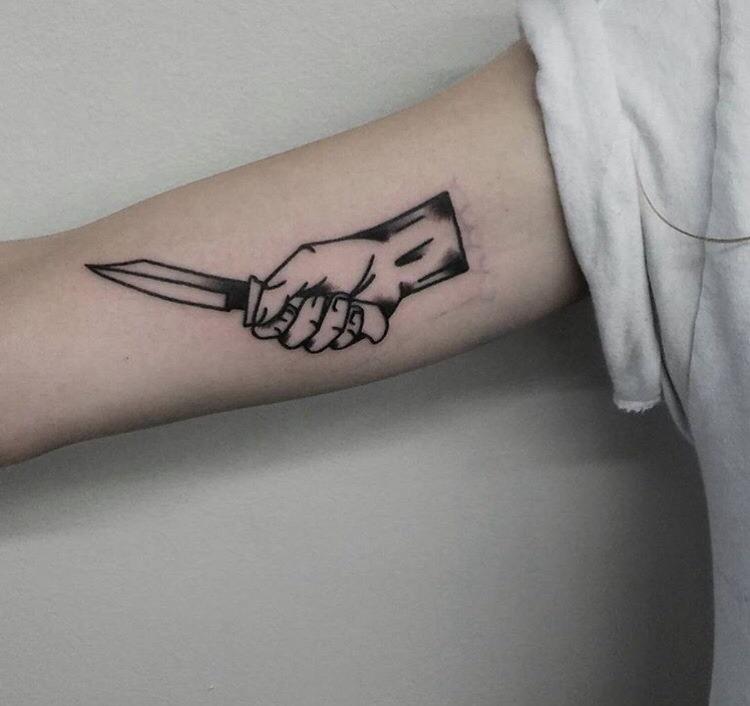 Hand and knife tattoo