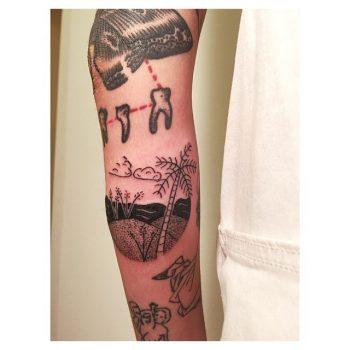 Hand poked beach scene tattoo