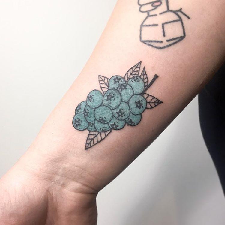 Hand poked blueberries tattoo