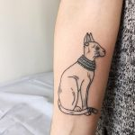 Hand poked goddess bastet tattoo