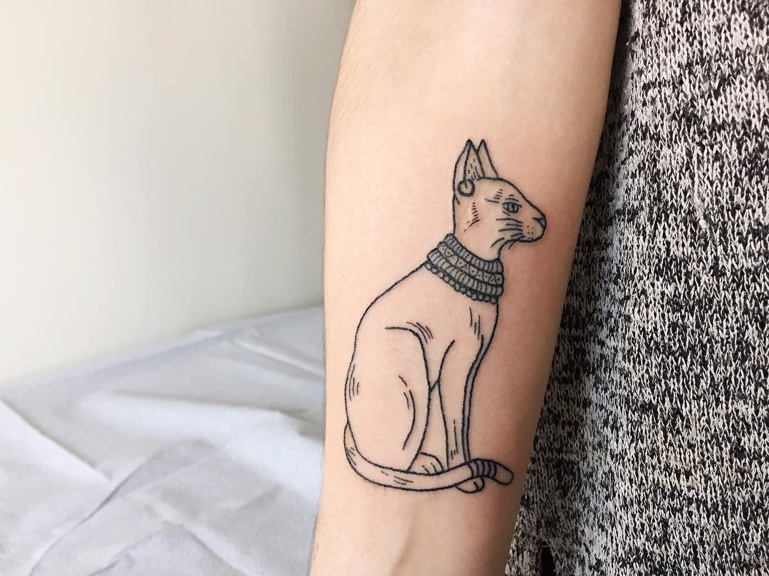 Hand poked goddess bastet tattoo