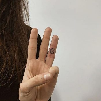 Handpoked g tattoo by ann pokes