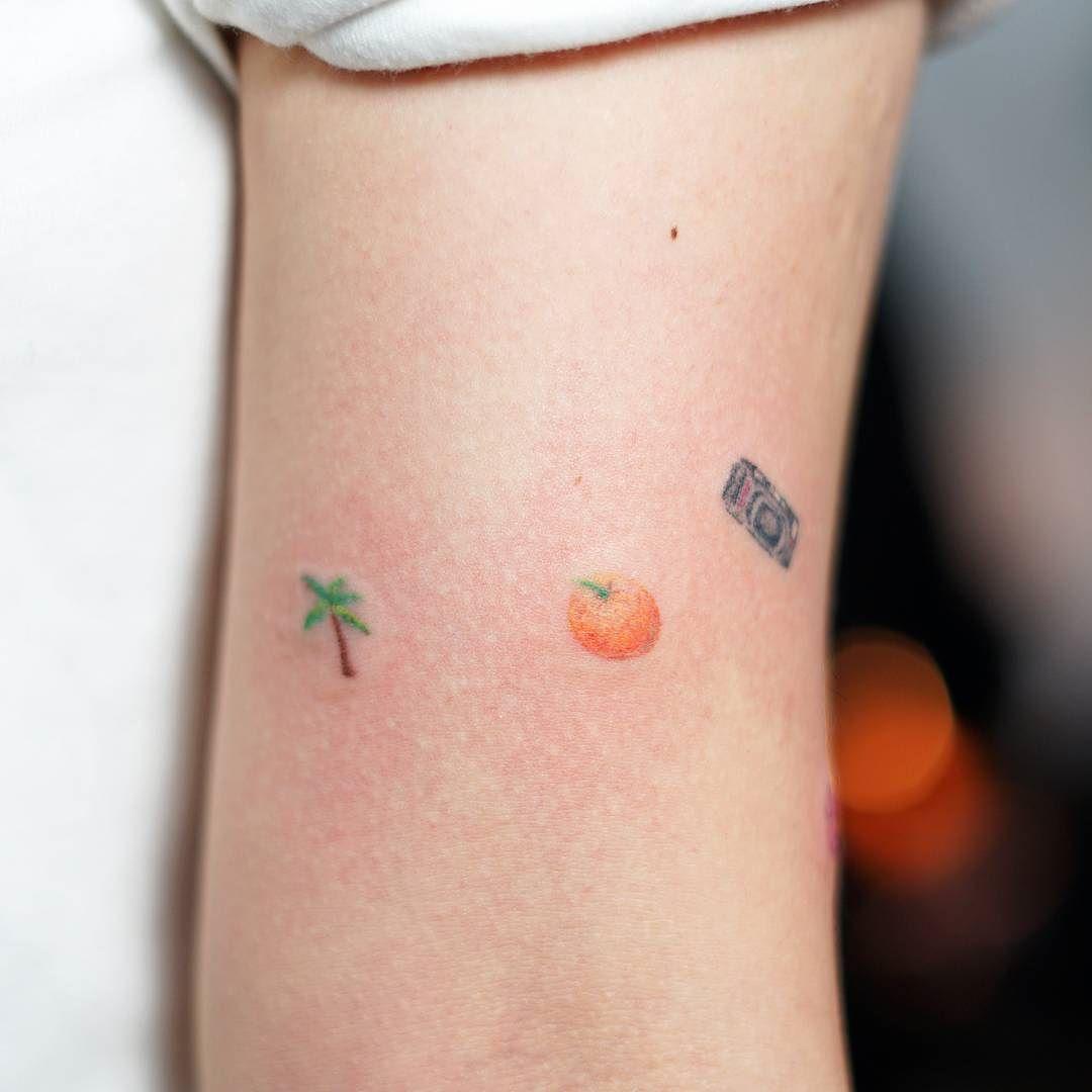 Handpoked palmtree orange and photo camera tattoo