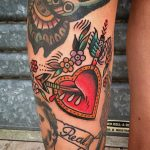 Heart and broken arrow tattoo