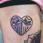 Heart shaped cats tattoo
