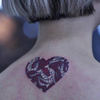 Heart shaped snakes tattoo