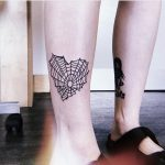 Heart shaped spiderweb tattoo
