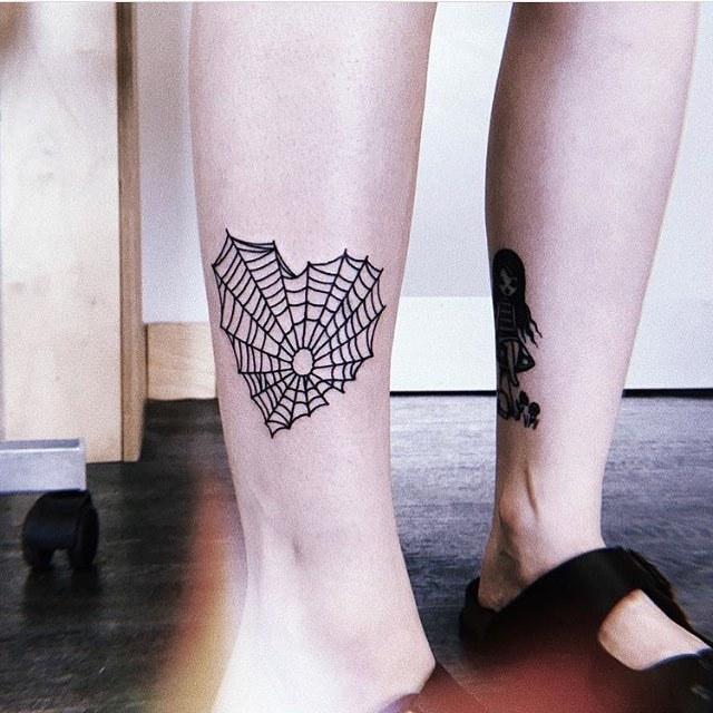 Heart shaped spiderweb tattoo