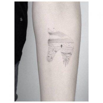 Horse head shaped landscape tattoo