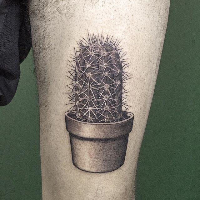 Hyper realistic dotwork cactus tattoo