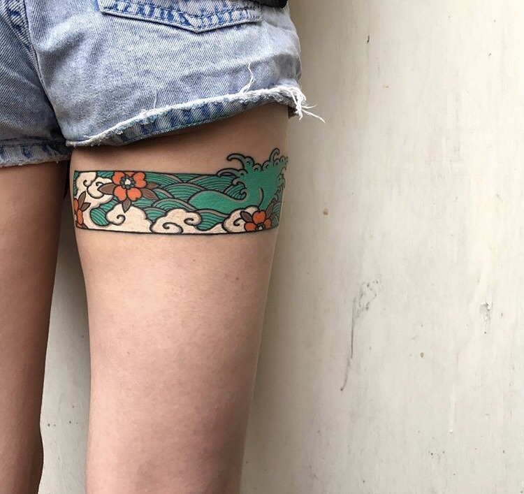 Japanese wave tattoo on the thigh