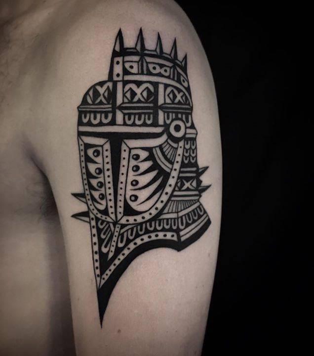 Knight helmet tattoo on the arm