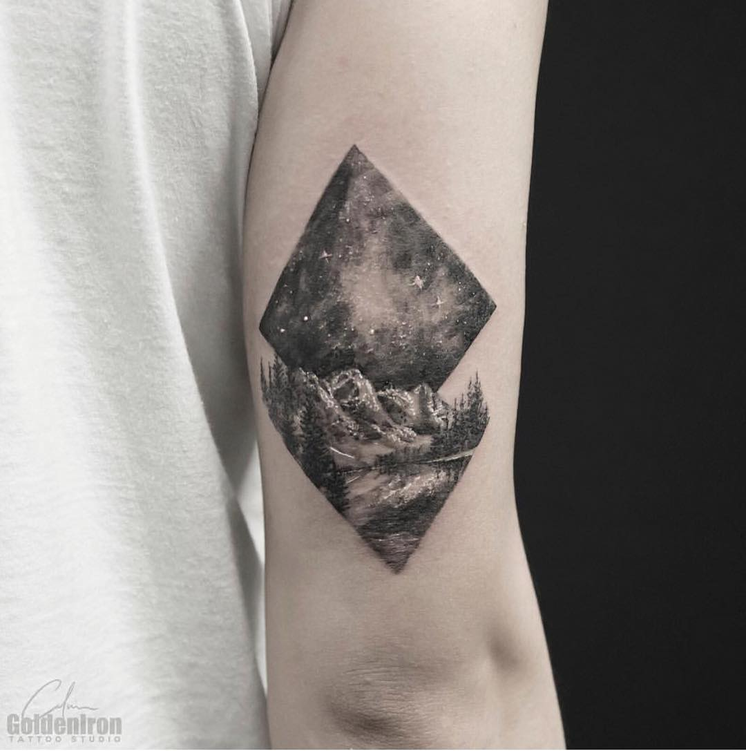 Landscape and sky tattoo