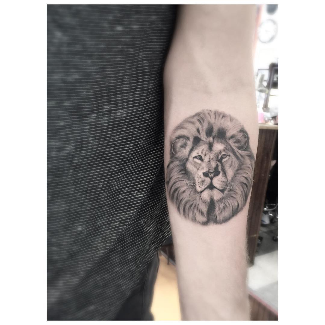 Lion head tattoo on the arm