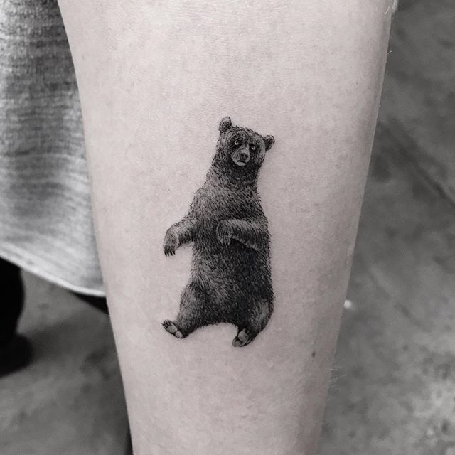 Lovely black bear tattoo