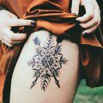 Mandala and crossed arrows tattoo