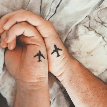 Matching airplane tattoos