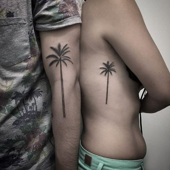 Matching palm tree tattoos for a couple