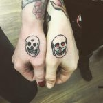 Matching skull tattoos for a couple