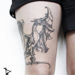 Medieval dragon tattoo on the thigh