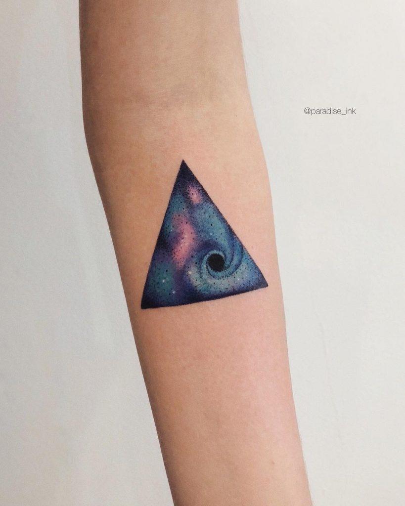 Miniature triangle space tattoo