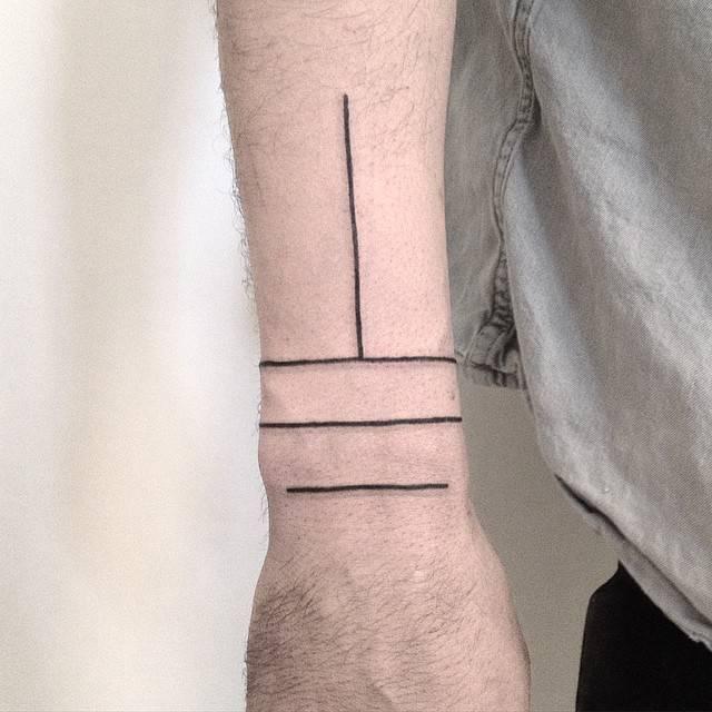 Minimalist style linear wrist tattoo