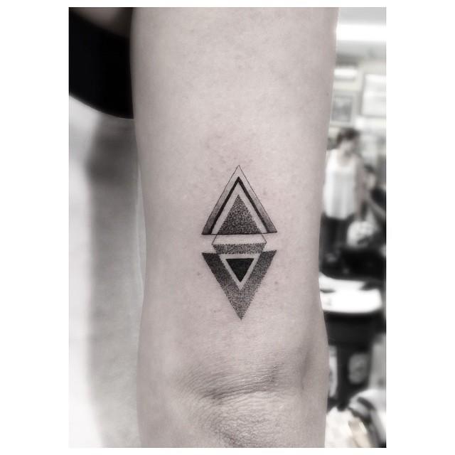 Minimalist black and grey triangles tattoo