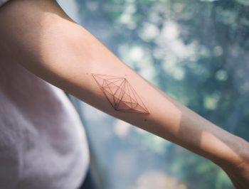 Minimalist linear diamond tattoo