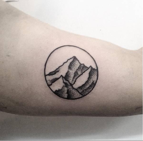 Minimalist mountain in a circle tattoo