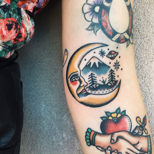 Moon and landscape tattoo