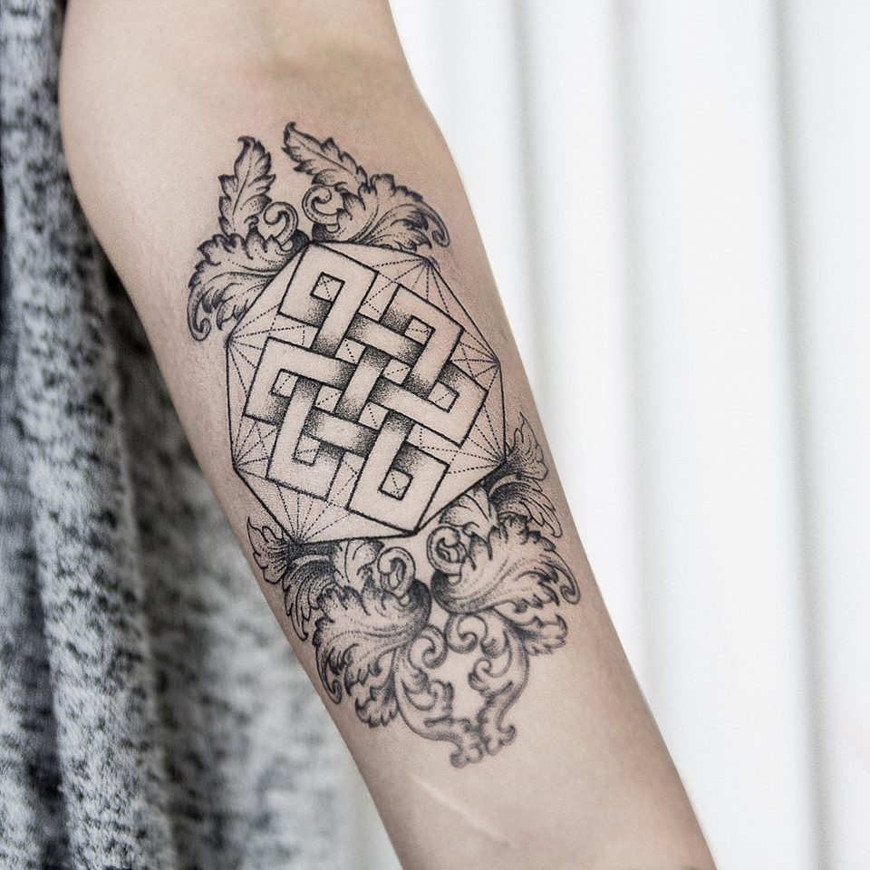 Mystic knot and baroque ornaments tattoo