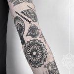 Nail, eye and mandala tattoos