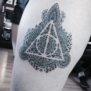 Ornamental deathly hallows tattoo