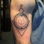 Ouroboros and geometric shapes tattoo