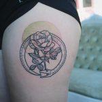 Ouroboros and rose tattoo