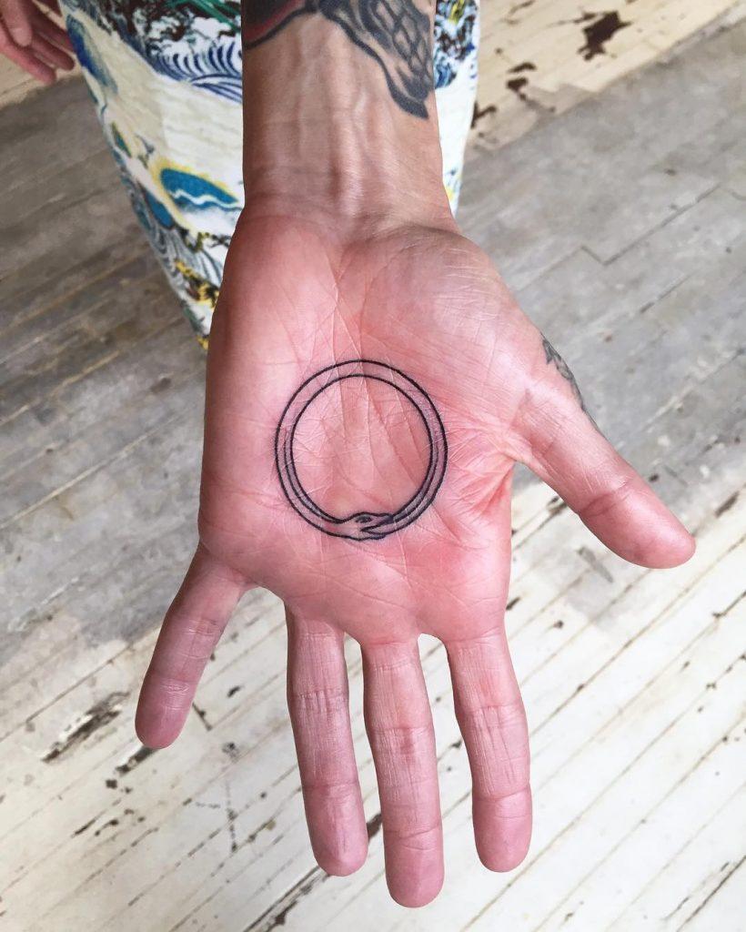 Outline ouroboros tattoo