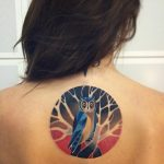 Owl tattoo on the back