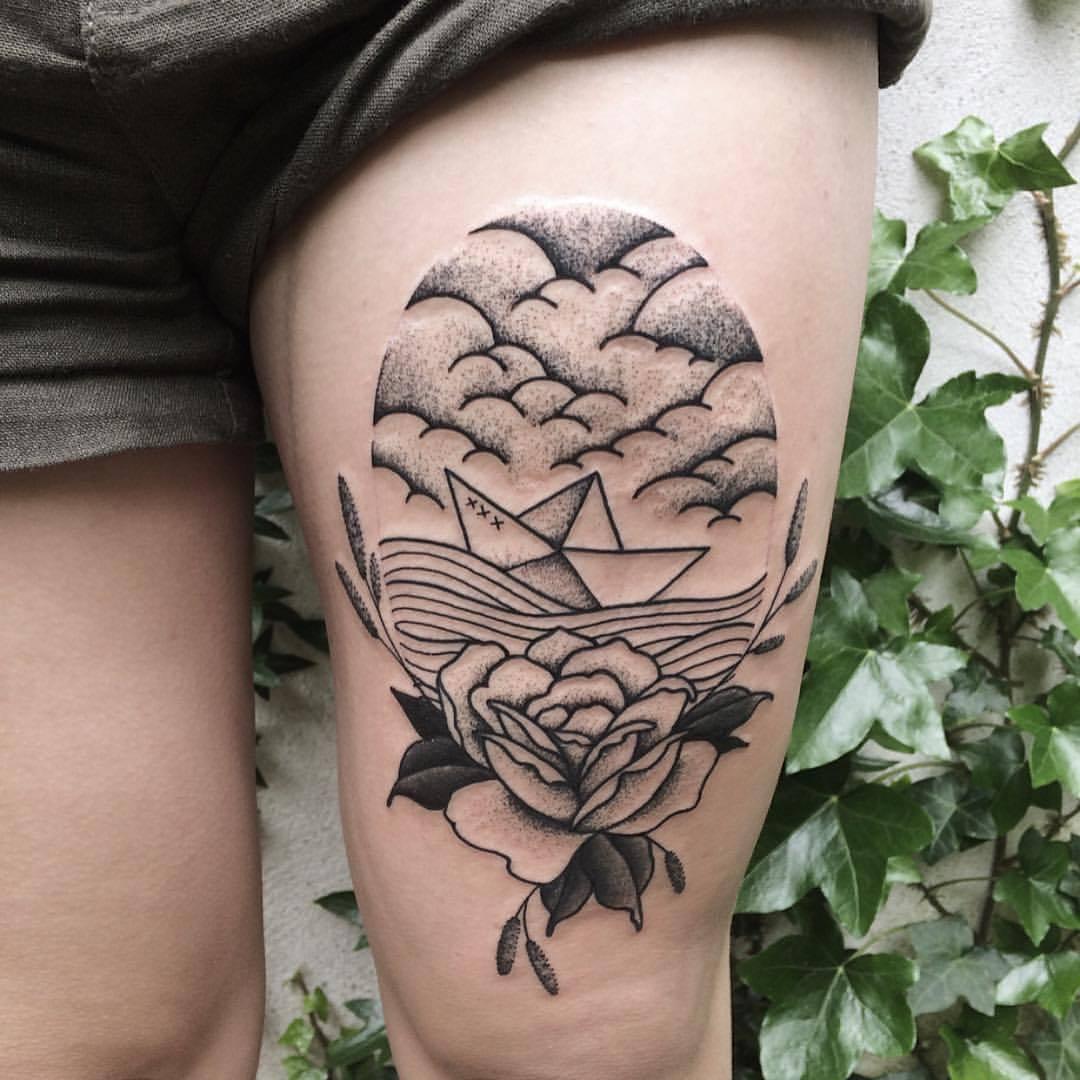 Paper boat in a sea tattoo by roald vd broek