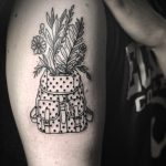 Polka dot backpack and plants tattoo
