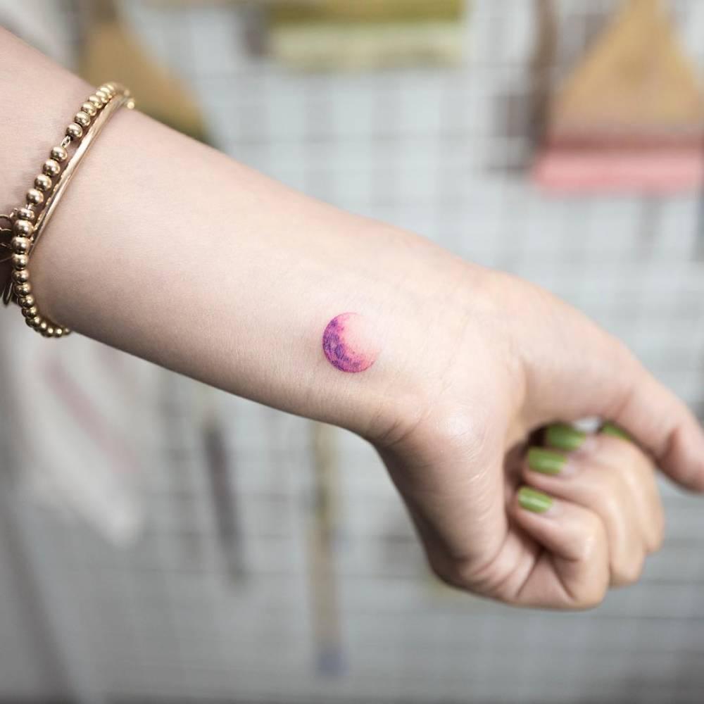 Purple planet tattoo