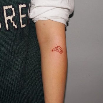 Red croissant tattoo