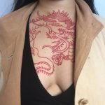 Red oriental style dragon tattoo