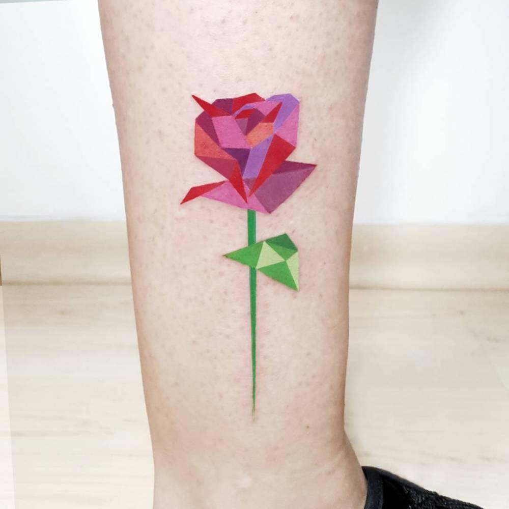 Red polygonal rose tattoo