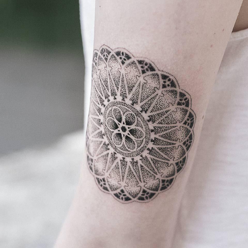 Rose window themed geometric mandala tattoo