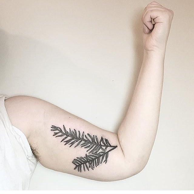 Rosemary twig tattoo on the bicep