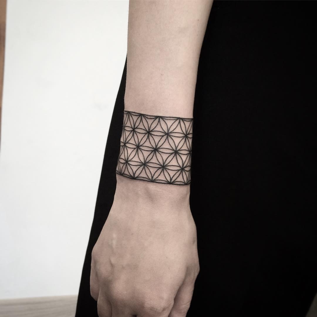 Sacred geometry bracelet tattoo